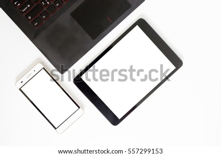 Office desk laptop smartphone and tablet on white. Top view with copy space
