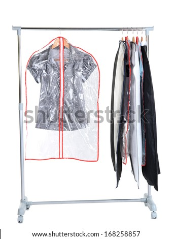 Office Female Clothes In Cases For Storing On Hangers, Isolated On White