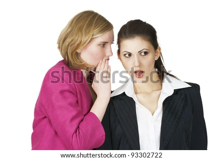 Office girl sharing secret with shocked expression
