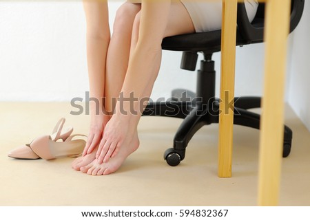 office relaxation. office massage foot pain from high heels fatigue and relaxation r