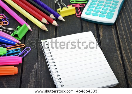 Office tools and notepad on wooden table