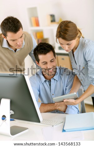 Office workers using tablet and computer