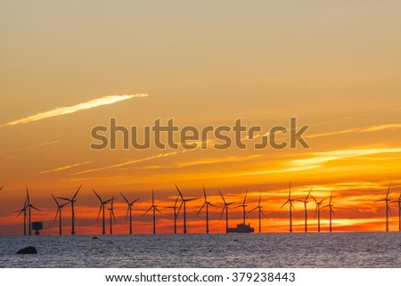 Offshore wind park in Oresund between Denmark and Sweden in sunset