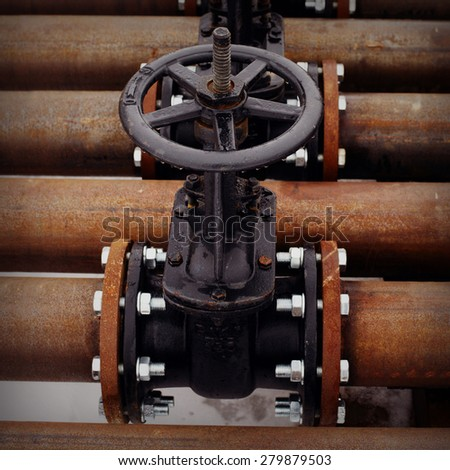 Oil and gas pipeline valves on a rusty piping