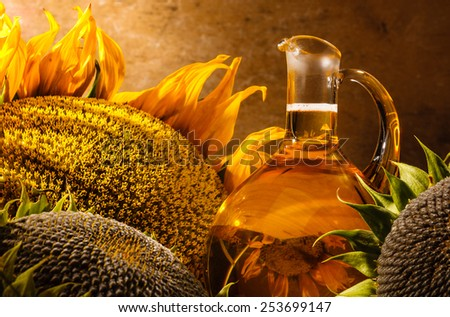 Oil bottle and sunflowers still life