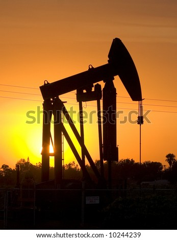 Oil derrick at sunset.