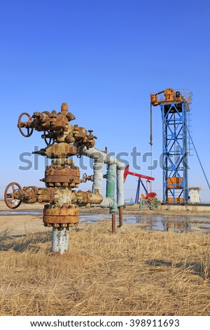 Oil pipeline and pumping unit, closeup of photo