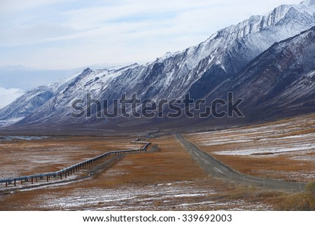 oil pipeline with mountain in northern alaska
