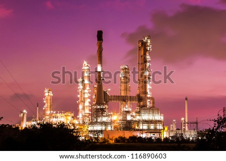 oil refinery plant and smoke at twilight morning
