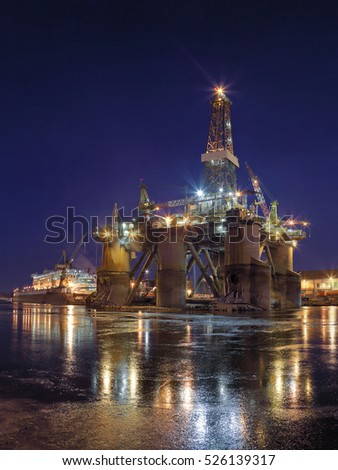 Oil rig under construction at night in Gdansk, Poland.