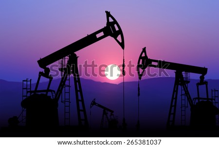 oil well plant against sunset