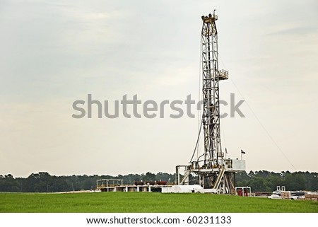 Oil well, rig, field, grass, green, sky, energy, drilling, gray, pump, equipment, swell head, horizontal format,