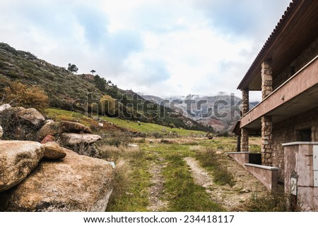 Old abandoned stone house in the mountains landscape