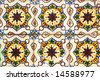 Old  and colored tiles  in a Portuguese wall. - stock photo