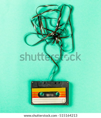 Old audio cassettes on turquoise background