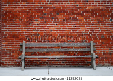 Old bench against brick wall