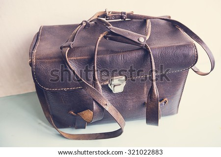 old black leather bag on white background