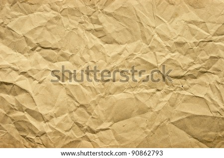 Old blank crumpled paper in yellow tone