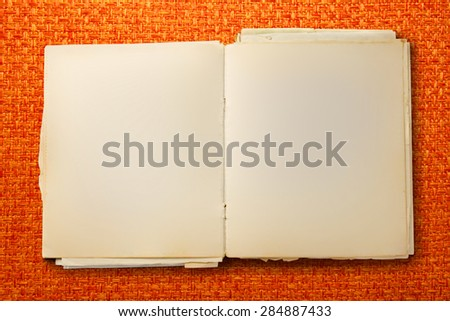 Old blank notebook open on colorful background