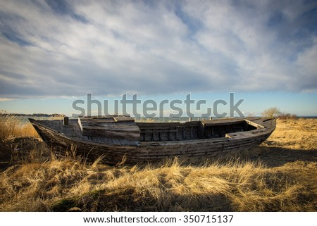 old boat in dry grass