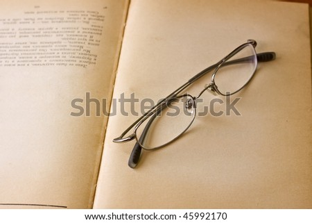 old book with reading glasses
