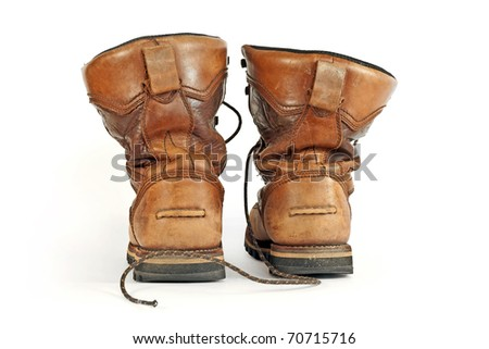 Old boots of brown color isolated on a white background. The photo of the footwear which have been removed in studio 8