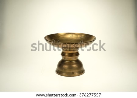 Old brass tray with pedestal isolated on white background