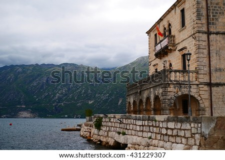 Old brick building by the sea, very cloudy day, Kotor, Montenegro, Eastern Europe