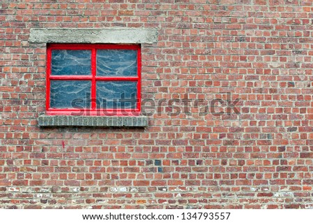 Old brick wall background with red window and copy space