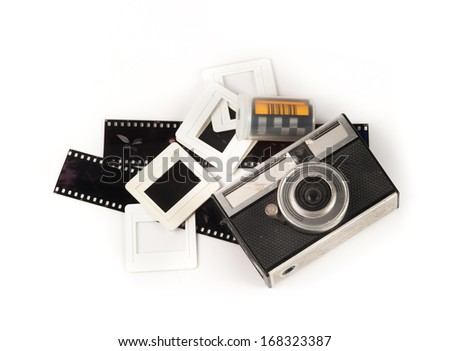 old camera and blank film strip on White background