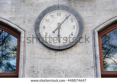 Old clock on the wall outdoor