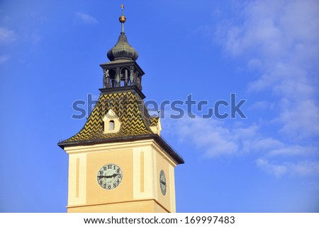 Old clock tower with blue sky on background