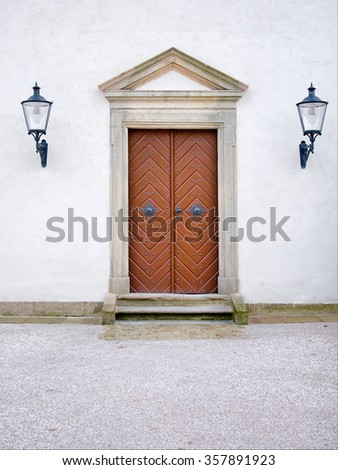 old copper-covered door with two lamps