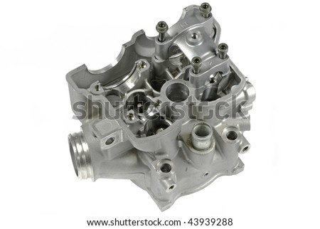 Old cylinder head from a damaged motorcycle racing engine isolated on white background ... top view