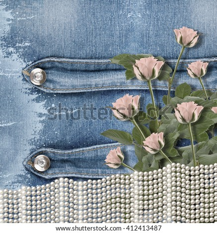 Old denim background with pearls and pink roses
