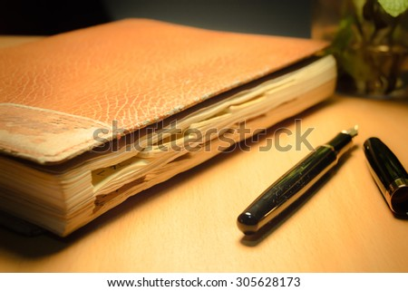 old diary and pen