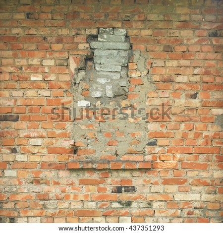 Old dilapidated brick wall with window. Vintage background.