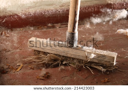 Old dirty broom on the floor