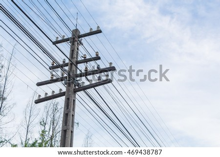 old electricity pole with blue sky and cloud background