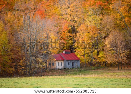 Old farm in Canada among colored trees
