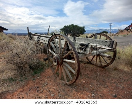 Old fashioned antique wooden cart outdoors in the western prairie - landscape color photo