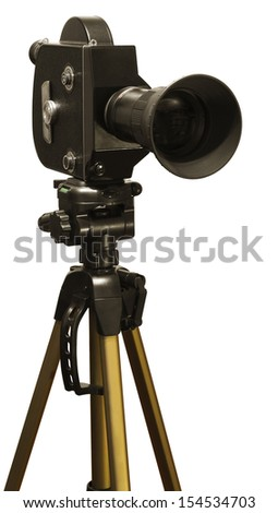 Old fashioned movie camera on a tripod close-up isolated on a white background.