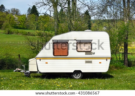 Old-fashioned 1980s caravan on a camping site in Belgium.