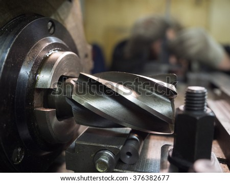 Old geen  milling machine, closeup, metalworking