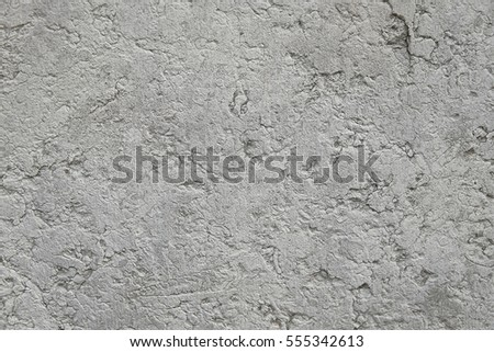 Old grey stone concrete wall background texture close up