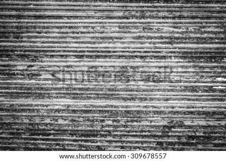 Old grunge wall texture background in black and white