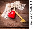 Old intage key and red heart. Key of my heart concept. Valentine's day greetings. - stock