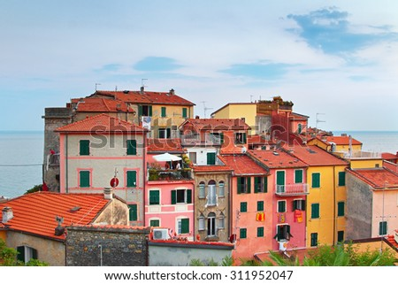 Old Italian village with colorful houses at the sea, Tellaro, Italy. Summertime.