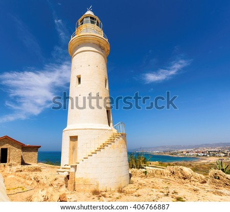 Old lighthouse on the Mediterranean coast near the city of Paphos in summer day and blue sky