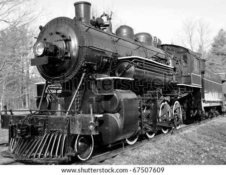 old locomotive in black and white